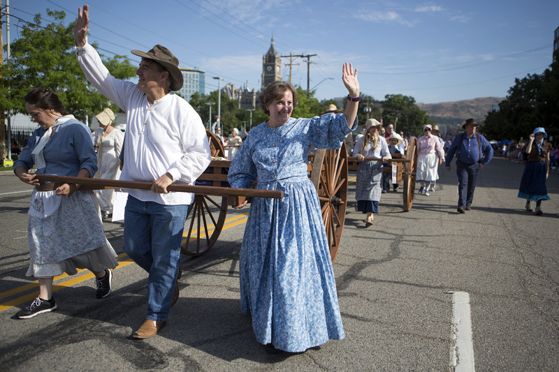Kathy Tidwell, right, Tony Tidwell and Tracy Biggs walk with Sons of Utah Pioneers in the Days of '47 Parade in Salt Lake City on Tuesday, July 24, 2018.