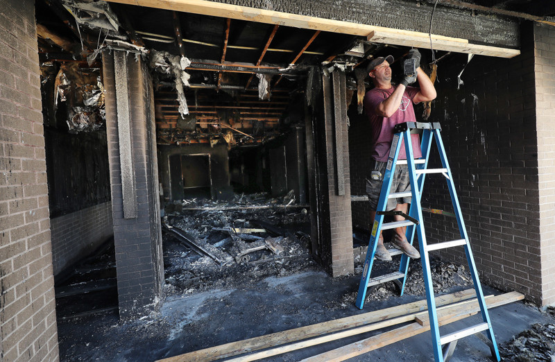 An entrance is covered after a fire at a meetinghouse of The Church of Jesus Christ of Latter-day Saints at 3625 Doverhill Drive in Cottonwood Heights on Sunday, July 14, 2019.