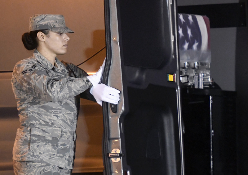 Airman 1st Class Italia Sampson closes a vehicle holding a transfer case containing the remains of Army Maj. Brent R. Taylor at Dover Air Force Base, Del., on Tuesday, Nov. 6, 2018. According to the Department of Defense, Taylor, 39, of Ogden, Utah, died Nov. 3, 2018, in Kabul province, Afghanistan, of wounds sustained from small arms fire.