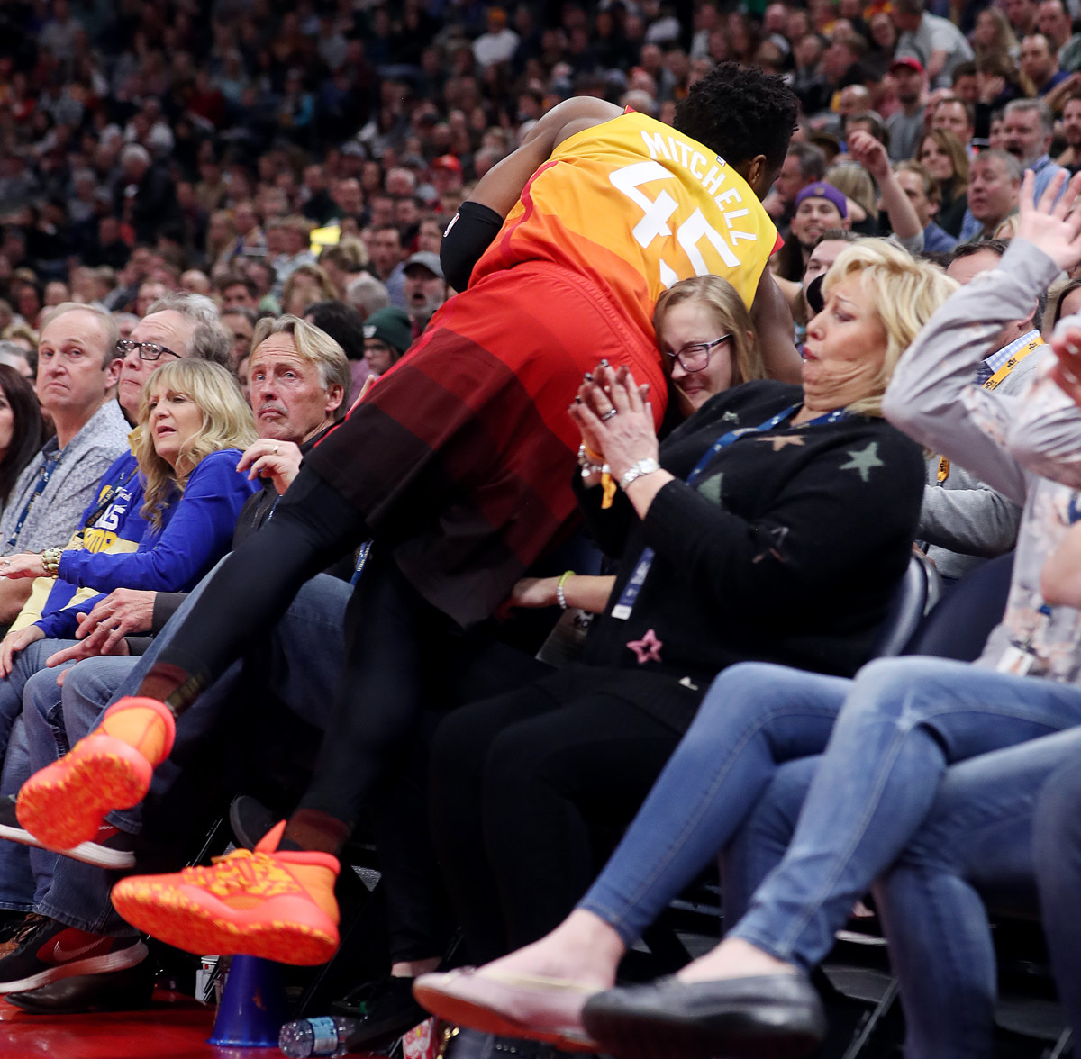 aeca4c73167 Donovan Mitchell's front row fall leaves Utah Jazz fan with 'bad' sprain  but lasting memory