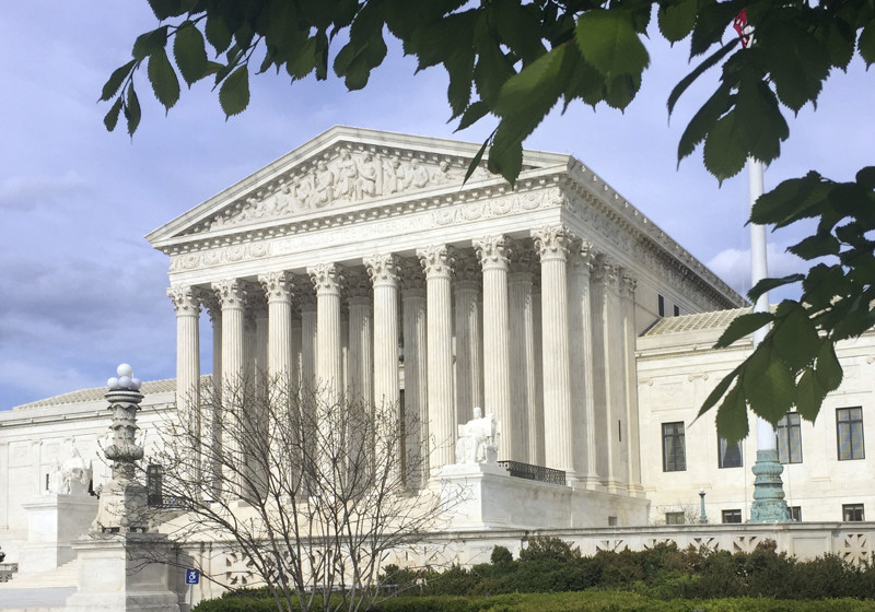 In this April 23, 2018 file photo, the Supreme Court in Washington. The Supreme Court has struck down a federal law that bars gambling on football, basketball, baseball and other sports in most states, giving states the go-ahead to legalize betting on sports. (AP Photo/Jessica Gresko)