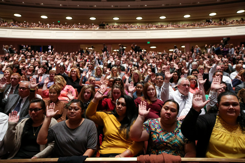 Conferencegoers raise their hands to sustain President Russell M. Nelson during the Saturday afternoon session of the 188th Semiannual General Conference of The Church of Jesus Christ of Latter-day Saints in the Conference Center in Salt Lake City on Saturday, Oct. 6, 2018.