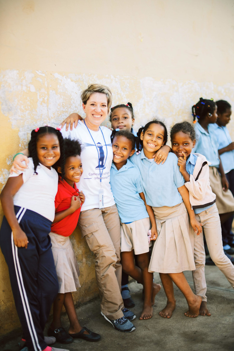 Melissa Judy, center, of the Community of Hope Foundation with schoolchildren in the Dominican Republic.