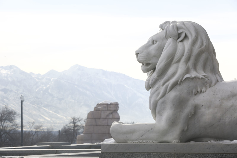 A stone lion guards one of the entrances to the Capitol in Salt Lake City on Friday, Jan. 25, 2019.