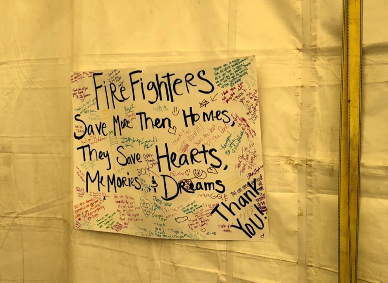 Handmade signs like this one in the canteen where firefighters eat are ubiquitous around Spanish Fork.