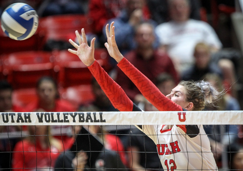 Utah middle blocker Berkeley Oblad (12) goes up for a block during the first round of the NCAA Volleyball Tournament as the University of Utah hosts Cleveland State at the Hunstman Center in Salt Lake on Thursday, Nov. 30, 2017. Utah wins the match 3 sets to none and advances to play Purdue University tomorrow.