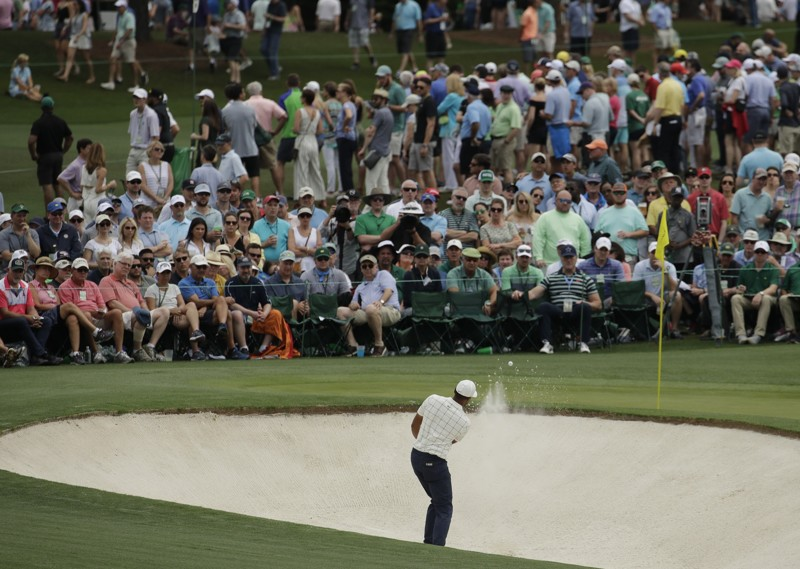 Tony Finau hits from a bunker on the second hole during the third round for the Masters golf tournament Saturday, April 13, 2019, in Augusta, Ga. (AP Photo/Charlie Riedel)