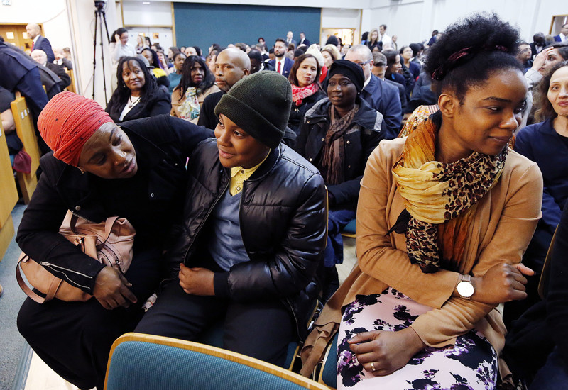 Jennifer Dixon-Reynolds, left, Donovan Reynolds and Tricia O. Reynolds talk before a meeting at the Hyde Park Chapel of The Church of Jesus Christ of Latter-day Saints in London on Thursday, April 12, 2018.