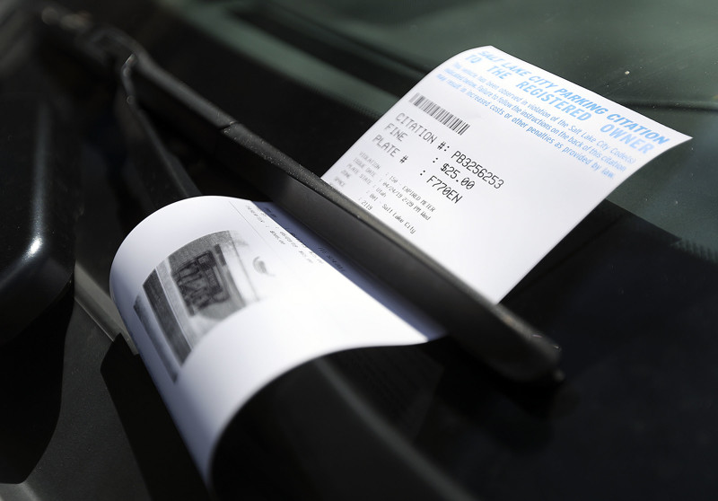 A parking ticket is tucked under a windshield wiper in Salt Lake City on Wednesday, April 24, 2019.