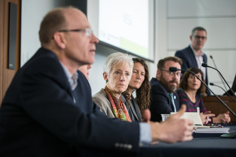 Salt Lake City sustainability director Vicki Bennett, center, listens to Utah Department of Environmental Quality Executive Director Alan Mathes during the event