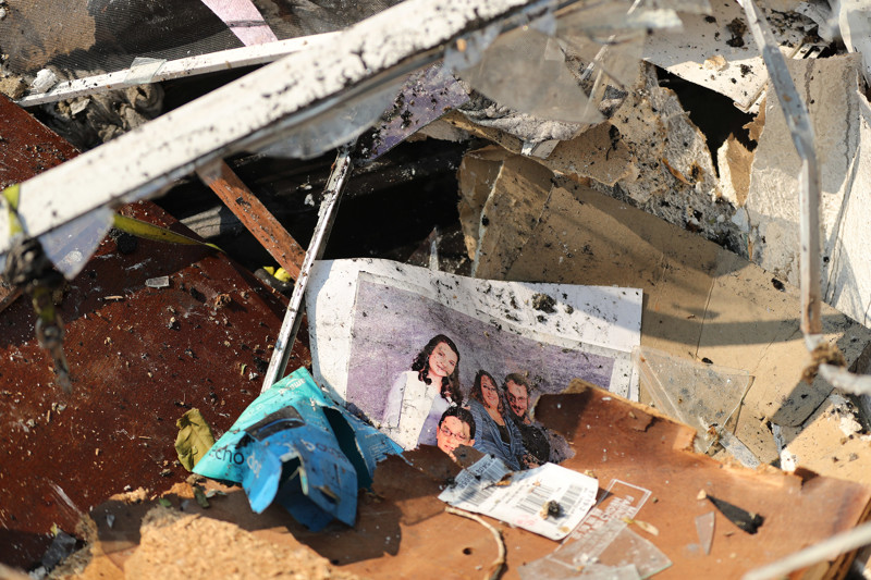 A photo lays in the rubble on Thursday, June 14, 2018, after a fire destroyed several homes in Moab on June 12.