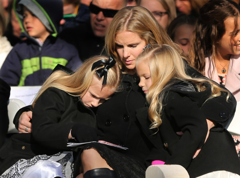 Emmy Gourley holds her children Madisen and Abigail during the German Day of Remembrance (Volkstrauertag) at Fort Douglas Military Cemetery in Salt Lake City on Sunday, Nov. 18, 2018.