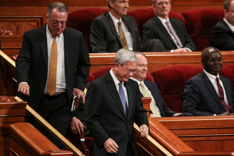 Elder Ulisses Soares, left, and Elder Gerrit W. Gong walk to their new seats after being called as members of the Quorum of the Twelve Apostles during a solemn assembly, part of the Saturday morning session of the 188th Annual General Conference of the LDS Church at the Conference Center in Salt Lake City on March 31, 2018.