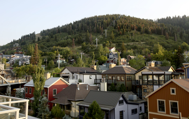 Treasure Hill rises behind homes in the Old Town neighborhood of Park City on Friday, Aug. 3, 2018. There is an open space initiative to save Treasure Hill from development, and Park City is pursing a bond for $48 million.
