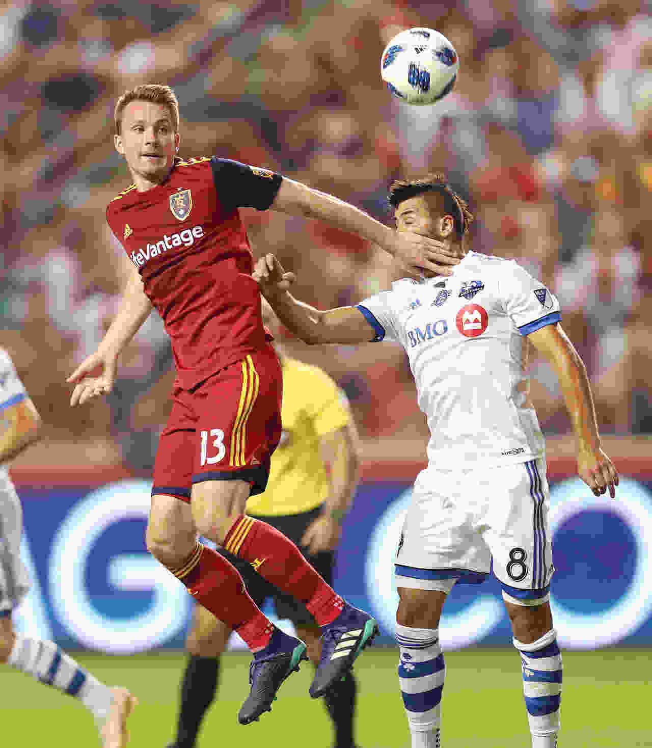 fd7e86d5b14 Real Salt Lake midfielder Nick Besler (13) and Montreal Impact midfielder  Saphir Taider (8) compete in Sandy on Saturday, Aug. 11, 2018.