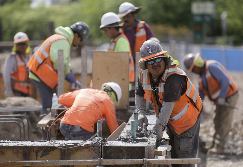 Nicholas Sarabria and other construction workers build a student housing complex next to Utah Valley University in Orem on Wednesday, July 17, 2019.
