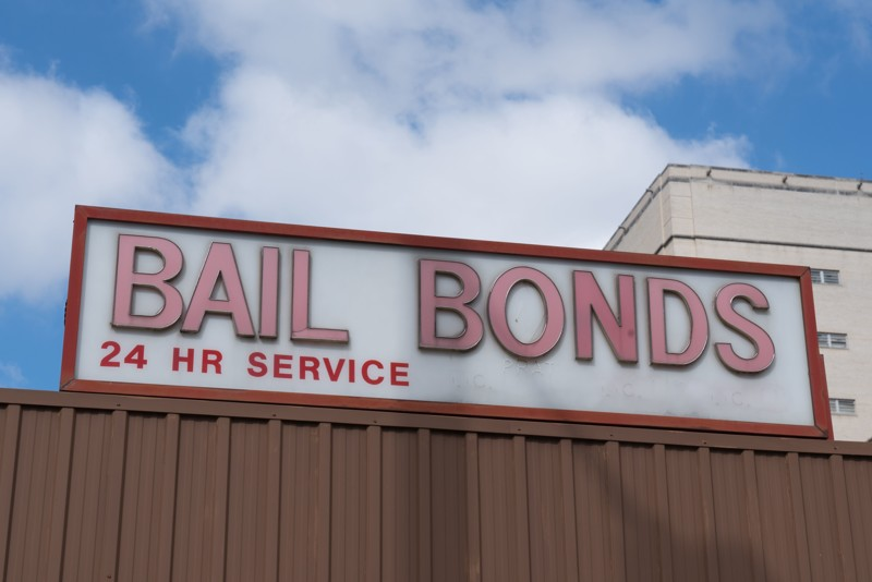Bail Bonds sign on top of building.
