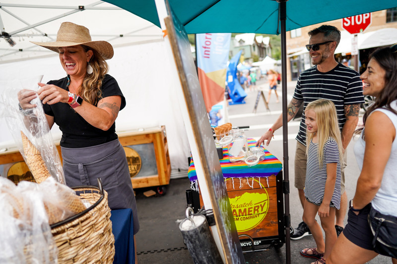 Kris May, owner of Wasatch Creamery Ice Cream Company, left, serves T.J. Stevenson, Esmé Stevenson and Jessica Privett, left to right, of Salt Lake City, at the Kimball Arts Festival in Park City on Saturday, Aug. 3, 2019.