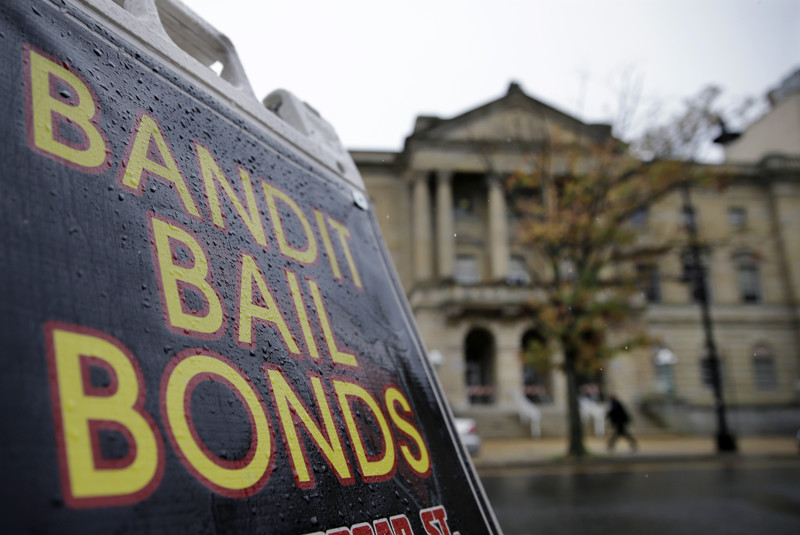 A sign is seen outside a bail bondsman across the street from Mercer County criminal courthouse Thursday, Oct. 23, 2014, in Trenton, N.J. (AP Photo/Mel Evans)