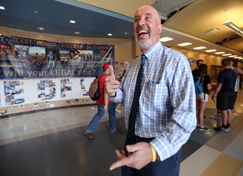 Principal Bart Peery talks to students as they walk by at Salem Hills High School in Salem on Thursday, May 24, 2018.