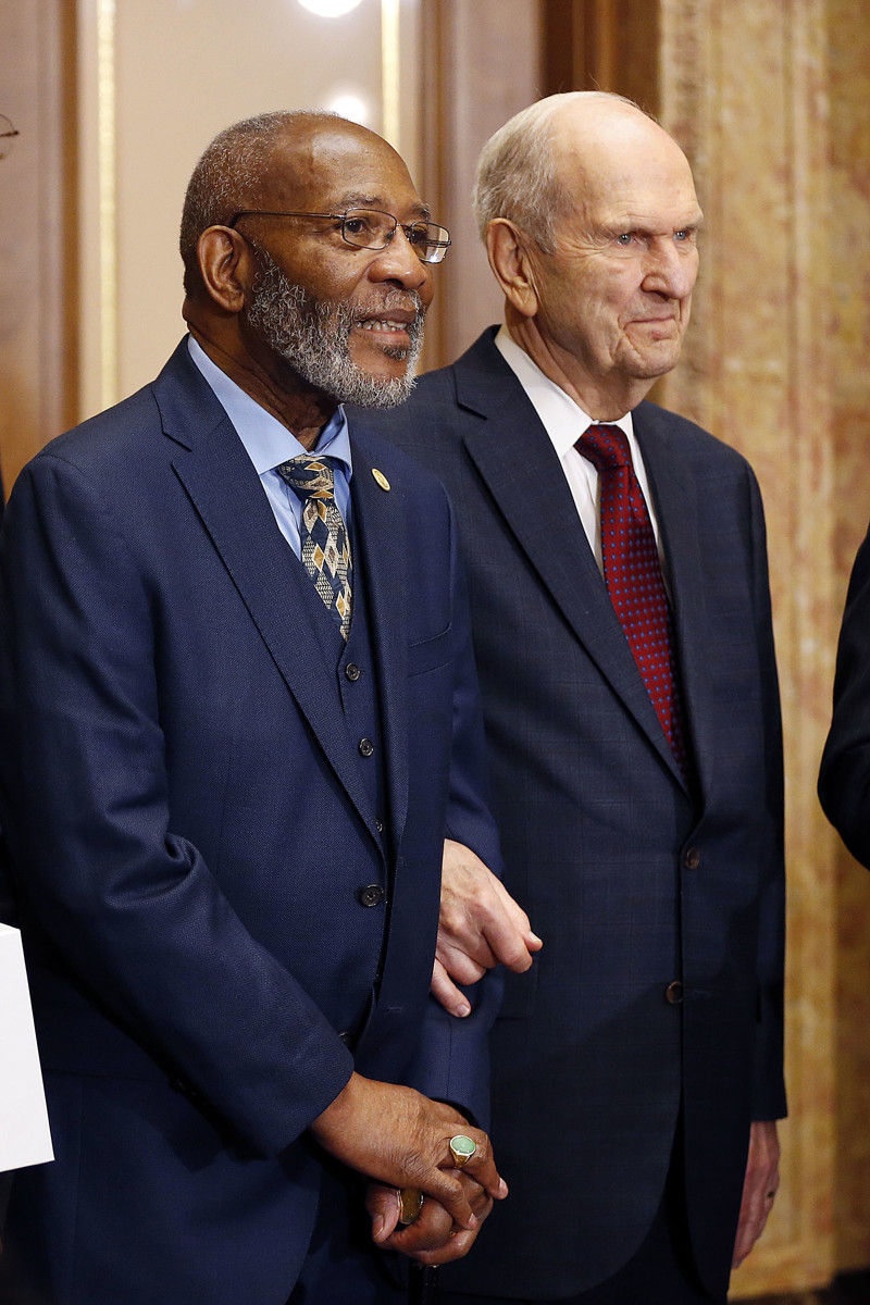 President Russell M. Nelson of The Church of Jesus Christ of Latter-day Saints, right, links arms with the Rev. Amos C. Brown, chairman of the NAACP's religious affairs committee, during a press conference in Salt Lake City on Thursday, May 17, 2018.