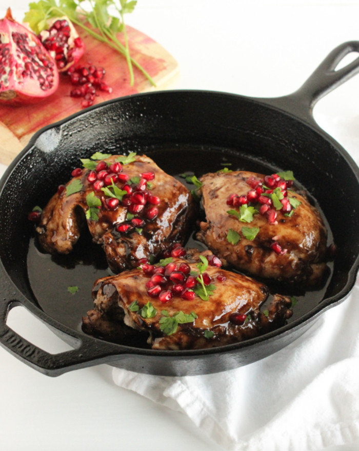 pomegranate balsamic chicken thighs in cast iron skillet