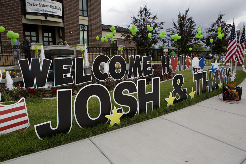A sign greeting Josh Holt and his wife Thamy outside the Old Dome Meeting Hall at Riverton City Park in Riverton, Utah, Monday, May 28, 2018.