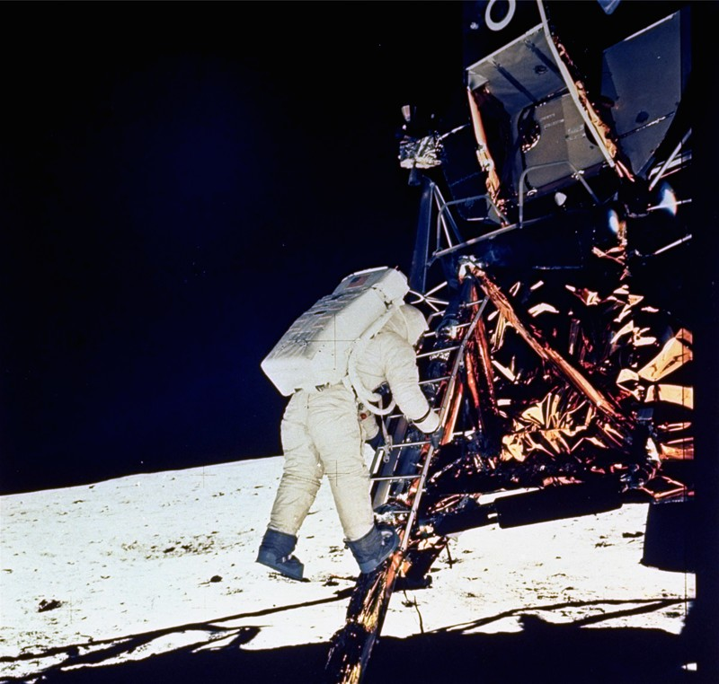 Astronaut Edwin E. Aldrin, Jr., lunar module pilot, descends steps of the lunar module ladder as he prepares to walk on the moon, July 20, 1969. This picture was taken by astronaut Neil A. Armstrong with a 70mm surface camera.
