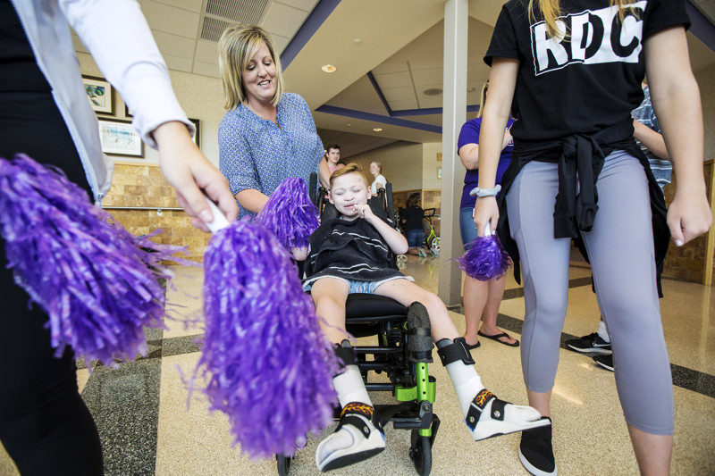 Janette Barton helps Liam Purser learn a cheer at the Kauri Sue Hamilton School in Riverton on Tuesday, Sept. 4, 2018.