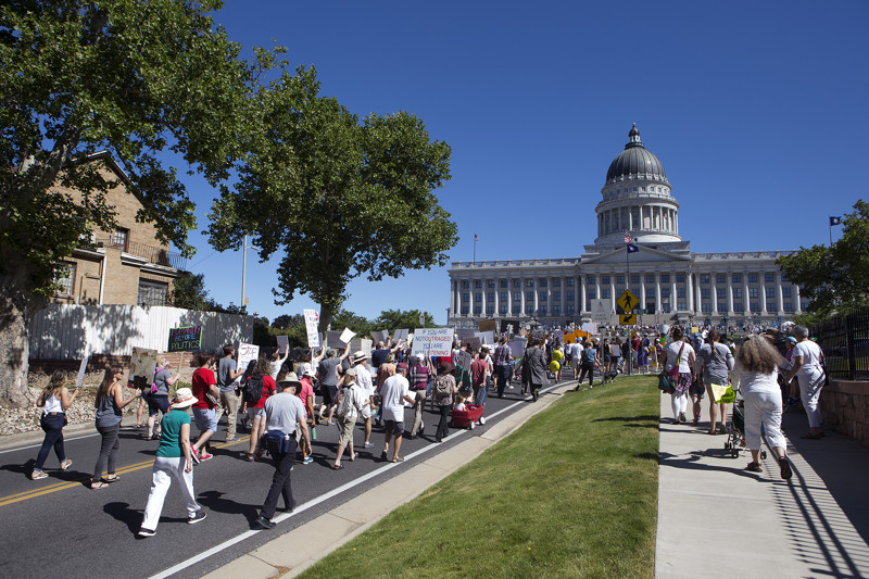 Protesters march toward the state Capitol during a rally against the separation of immigrant children from their parents in Salt Lake City on Saturday, June 30, 2018.