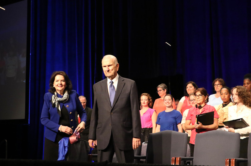 President Russell M. Nelson of The Church of Jesus Christ of Latter-day Saints and his wife, Sister Wendy Nelson, enter the Palais des congrès de Montréal auditorium prior to the start of the Aug. 18, 2018, devotional in Montreal.