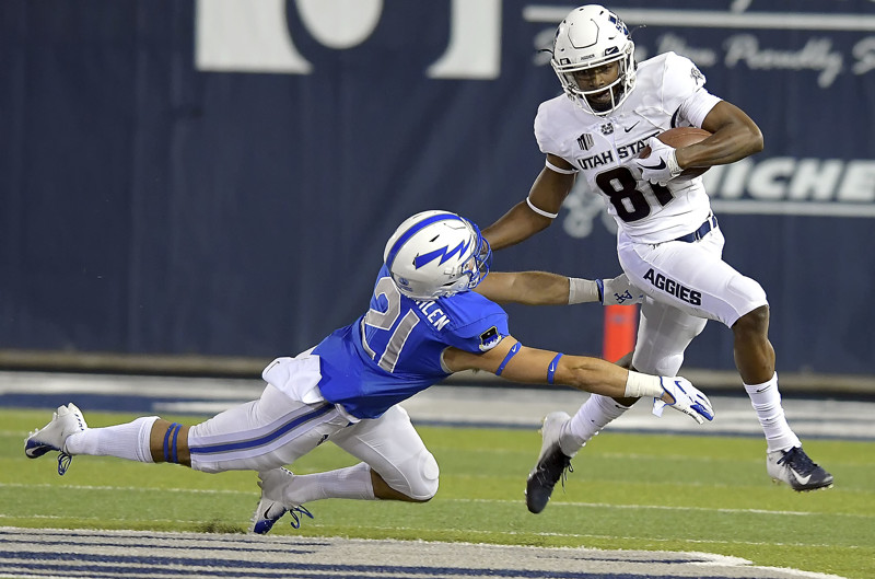 Utah State wide receiver Savon Scarver (81) stiff arms Air Force defensive back Bryce VonZurmuehlen (21) on a kickoff return during an NCAA college football game, Saturday, Sept. 22, 2018, in Logan, Utah.