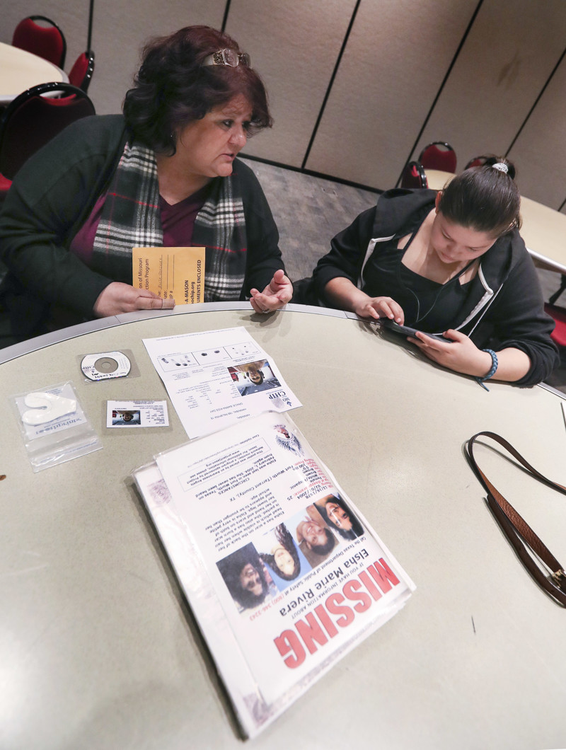 Elizabeth Rivera and her granddaughter, Elisa Gonzalez, attend the Salt Lake City Police Department's inaugural Missing In Utah event at the Miller Conference Center in Sandy on Saturday, March 9, 2019.