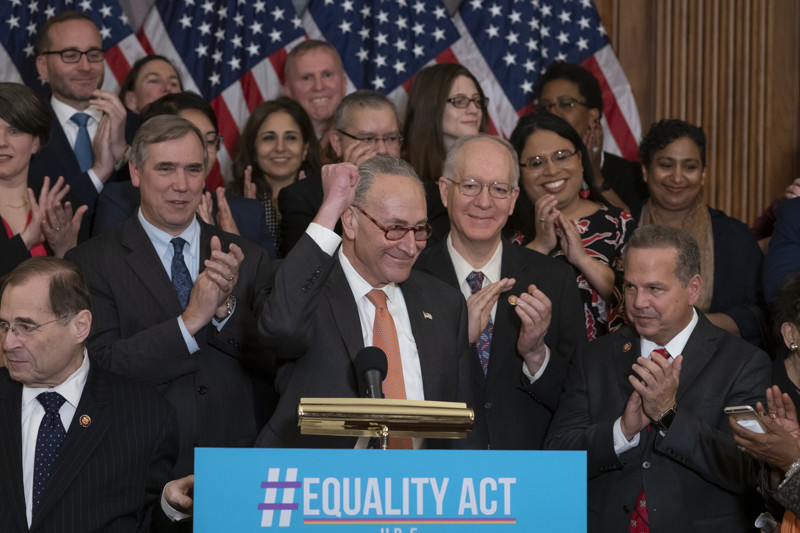 FILE - Senate Democratic Leader Chuck Schumer, D-N.Y., flanked by House Judiciary Committee Chairman Jerrold Nadler, D-N.Y., left, and Rep. David Cicilline, D-R.I., right, joins fellow Democrats in the House as they announce the introduction of The Equality Act, a comprehensive nondiscrimination bill for LGBT rights, at the Capitol in Washington, Wednesday, March 13, 2019.