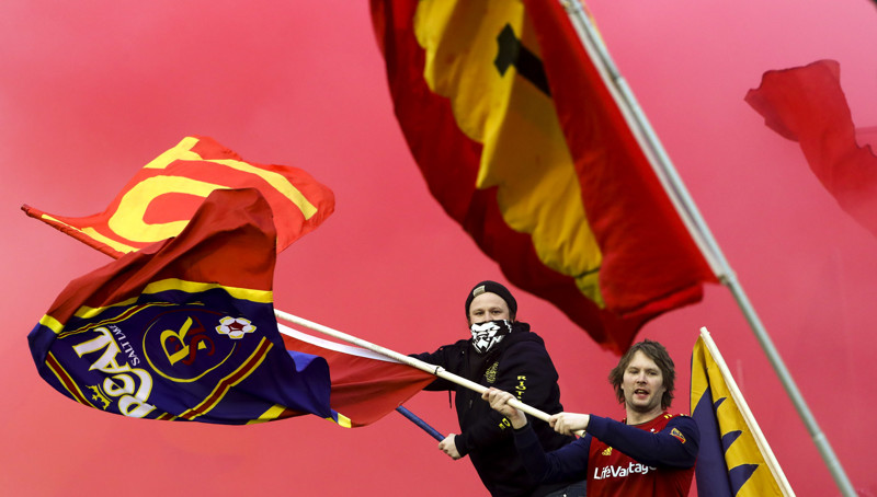Red smoke billows from the stands as RSL fans celebrate a goal during the RSL versus Orlando City soccer match at Rio Tinto Stadium in Sandy on Saturday, April 13, 2019.