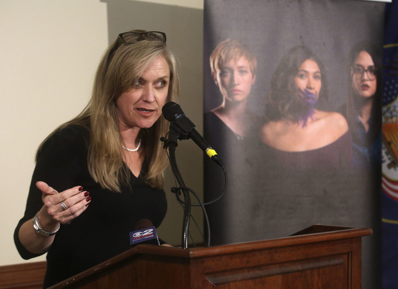 FILE - Jenn Oxborrow, Utah Domestic Violence Coalition executive director, speaks during a press conference about domestic-violence homicide, suicide and firearm safety at the Senate Building in Salt Lake City on Tuesday, Feb. 12, 2019.