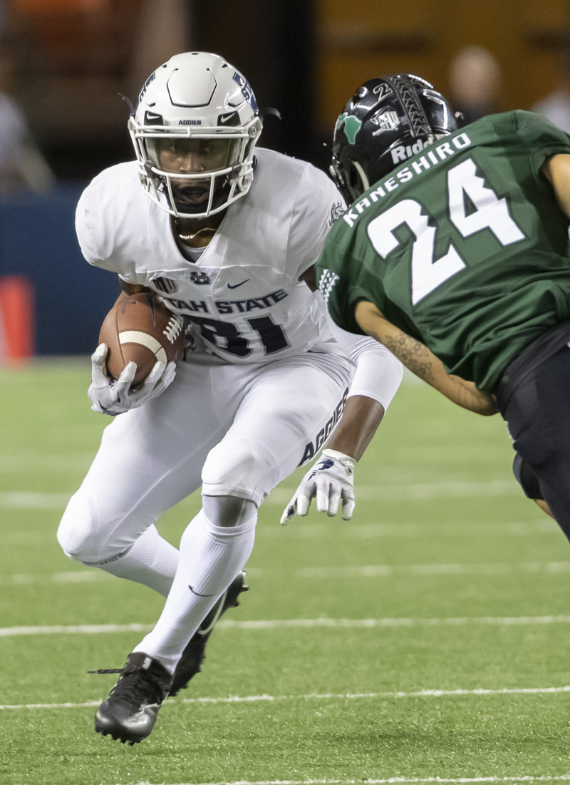 Utah State wide receiver Savon Scarver (81) attempts to get past Hawaii defensive back Kai Kaneshiro (24) in the first half of an NCAA college football game, Saturday, Nov. 3, 2018, in Honolulu.