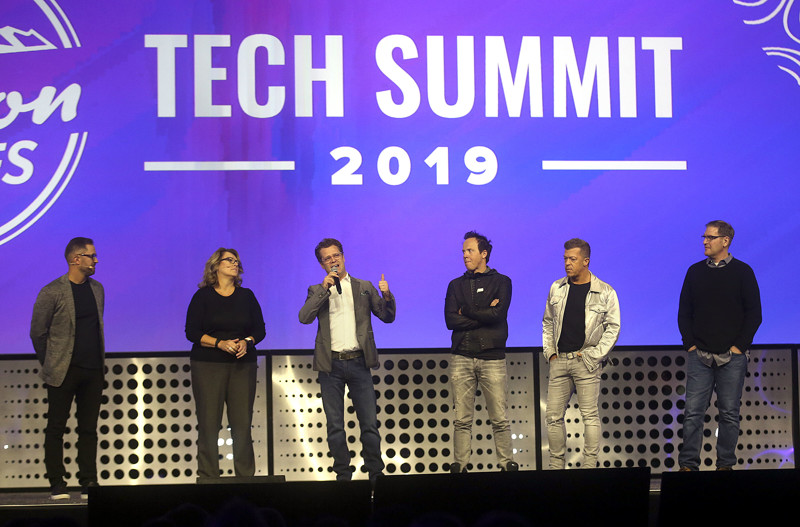 Pluralsight CEO Aaron Skonnard, Banyan CEO Carine Clark, Domo CEO Josh James, Qualtrics CEO Ryan Smith, Vivint CEO Todd Pedersen and InsideSales CEO Dave Elkington take the stage during the Silicon Slopes Tech Summit at the Salt Palace Convention Center in Salt Lake City on Thursday, Jan. 31, 2019.