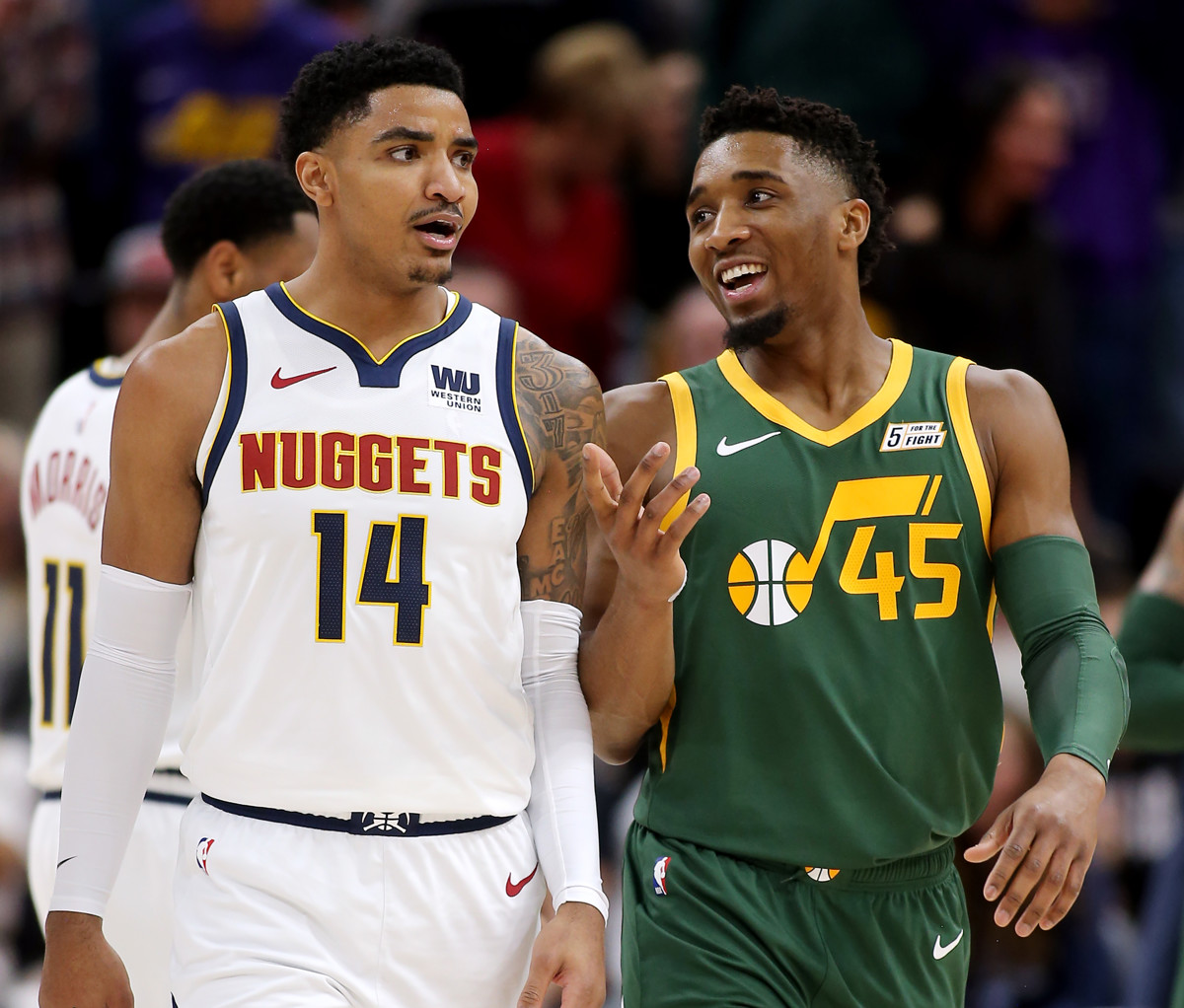 15ab1565b6c3 Denver Nuggets guard Gary Harris (14) and Utah Jazz guard Donovan Mitchell ( 45) talk as they walk up court as the Jazz and the Nuggets play an NBA ...