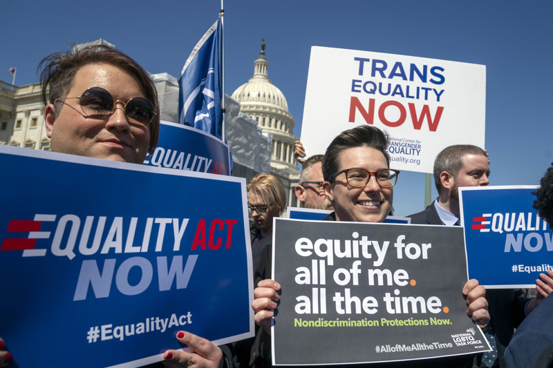 FILE - Advocates for the The Equality Act, a comprehensive nondiscrimination bill for LGBT rights, gather on Capitol Hill the day before the House Judiciary Committee holds a hearing on the legislation, in Washington, Monday, April 1, 2019.