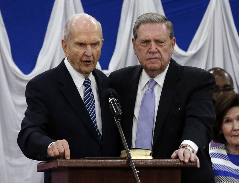 President Russell M. Nelson and Elder Jeffrey R. Holland of The Church of Jesus Christ of Latter-day Saints stand together as President Nelson gives a blessing during a special devotional in Nairobi, Kenya, on Monday, April 16, 2018.