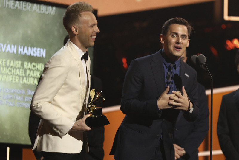 Benj Pasek, right, and Justin Paul accept the best musical theater album award for