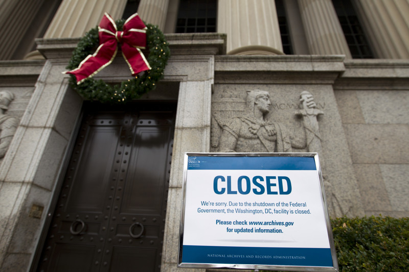 FILE - A closed sign is displayed at The National Archives entrance in Washington, Tuesday, Jan. 1, 2019, as a partial government shutdown stretches into its third week.
