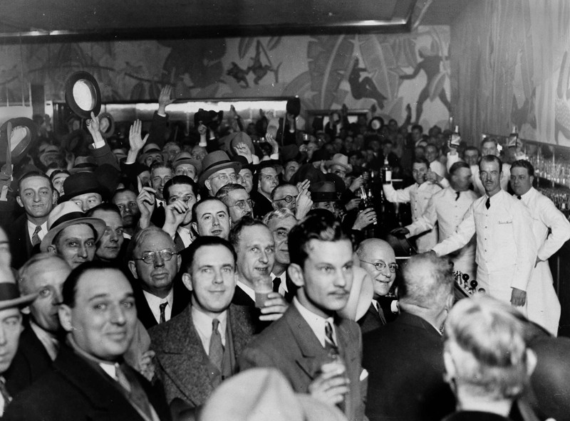 Crowds jam a downtown Chicago bar as word came from Utah that prohibition has been repealed, Dec. 12, 1933. Before the scramble for a legal drink, the crowd tossed a few hats in the air and let loose a round of cheers.