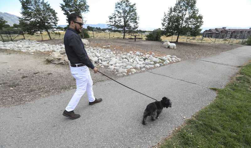 Daniel Torres is pictured with his dog at the Sandy Dog Park on Monday, July 29, 2019. Torres, who was undocumented when he served as a Marine in Iraq, has had a long road to obtain his U.S. citizenship.
