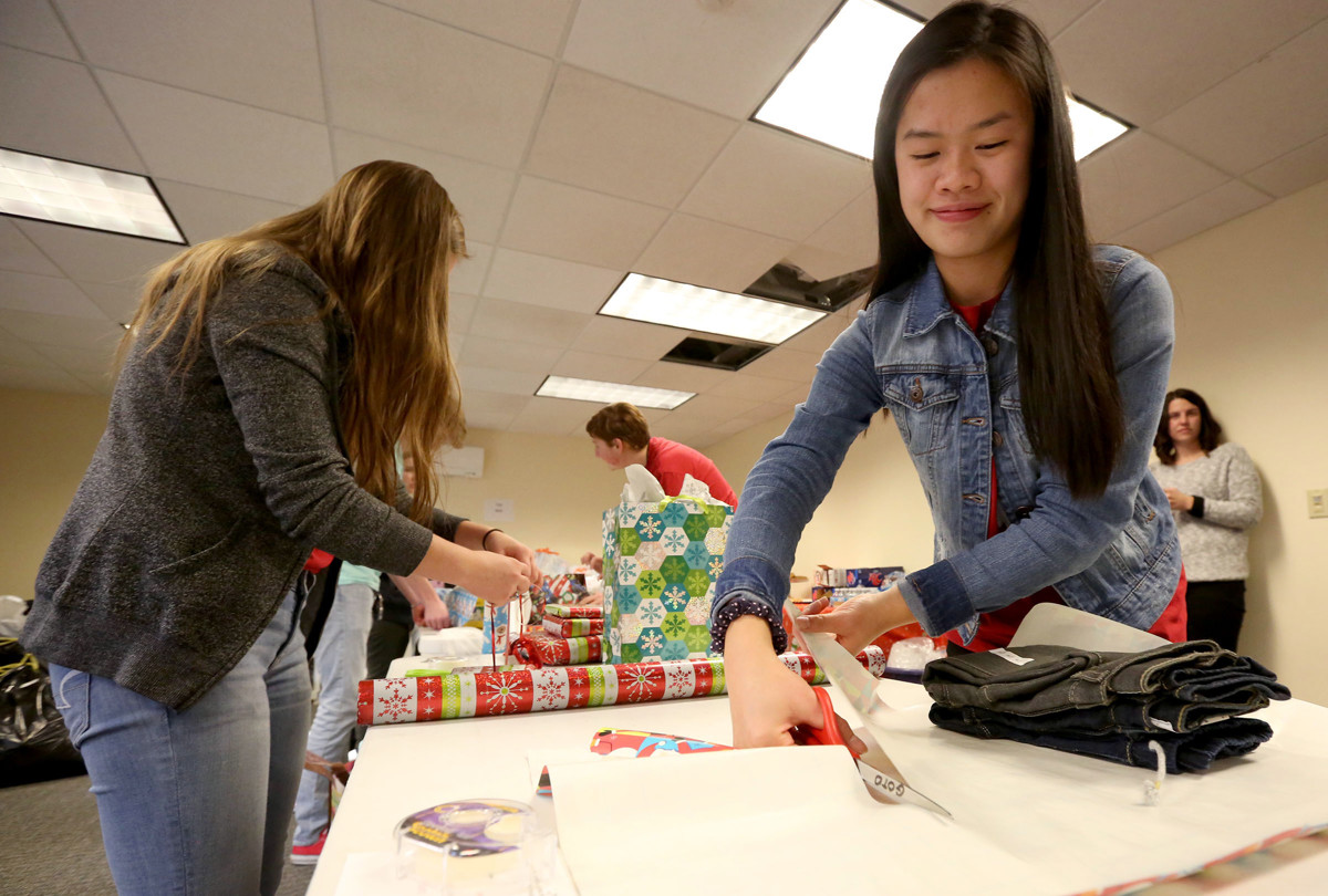 Holiday gift drive gives 1,500 kids Christmas presents   Deseret News