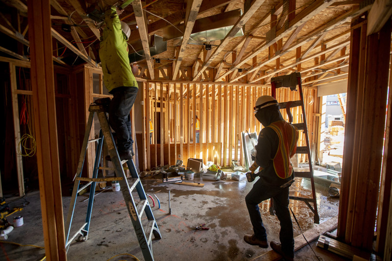 FILE - Construction workers work at the Garden Lofts, an affordable housing project being built in Salt Lake City, on Friday, Dec. 28, 2018.