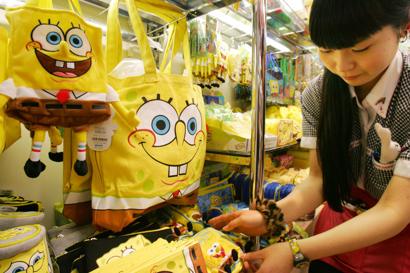 Kiddy Land toy store salesclerk Juri Igarashi arranges SpongeBob goods in Tokyo Tuesday, Dec. 5, 2006. In Japan, more than 30 companies are churning out goods plastered with SpongeBob's likeness, including everything from a 200 yen ($1.70) eraser to a 37,000 yen ($300) stuffed doll the size of a giant cushion. Kiddy Land manager Masanori Yamamoto says SpongeBob appeals to young people who want to be ahead of the crowd.
