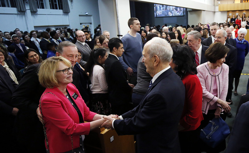 Elder Ron Partridge and Sister Marie Partridge, left, greet President Russell M. Nelson and Sister Wendy Nelson after a meeting at the Hyde Park Chapel of The Church of Jesus Christ of Latter-day Saints in London on Thursday, April 12, 2018.