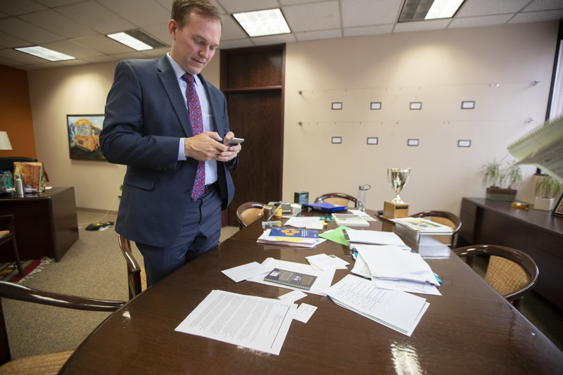 Congressman-elect Ben McAdams searches he phone after an interview in his Salt Lake County office as he prepares for his move to Washington, D.C., on Monday, Dec. 17, 2018.